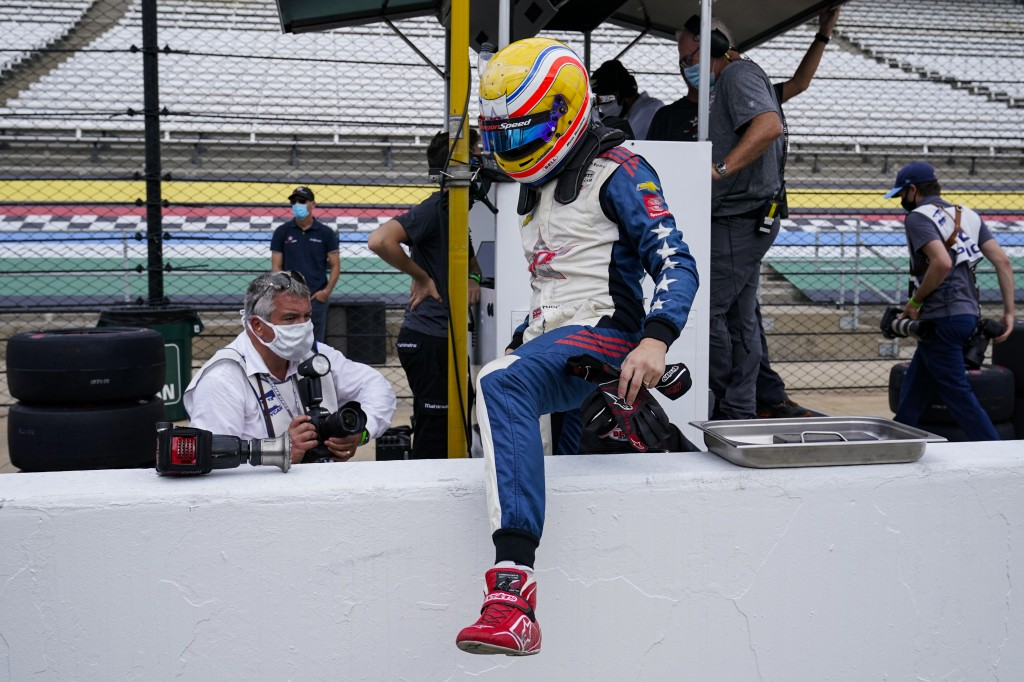Ben Hanley, of England, climbs over the pit wall during practice for the Indianapolis 500 auto race at Indianapolis Motor Speedway in Indianapolis, Th...