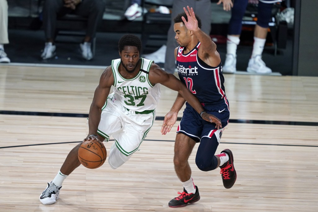 Boston Celtics' Semi Ojeleye (37) drives past Washington Wizards' Jerome Robinson (12) during the second half of an NBA basketball game Thursday, Aug....