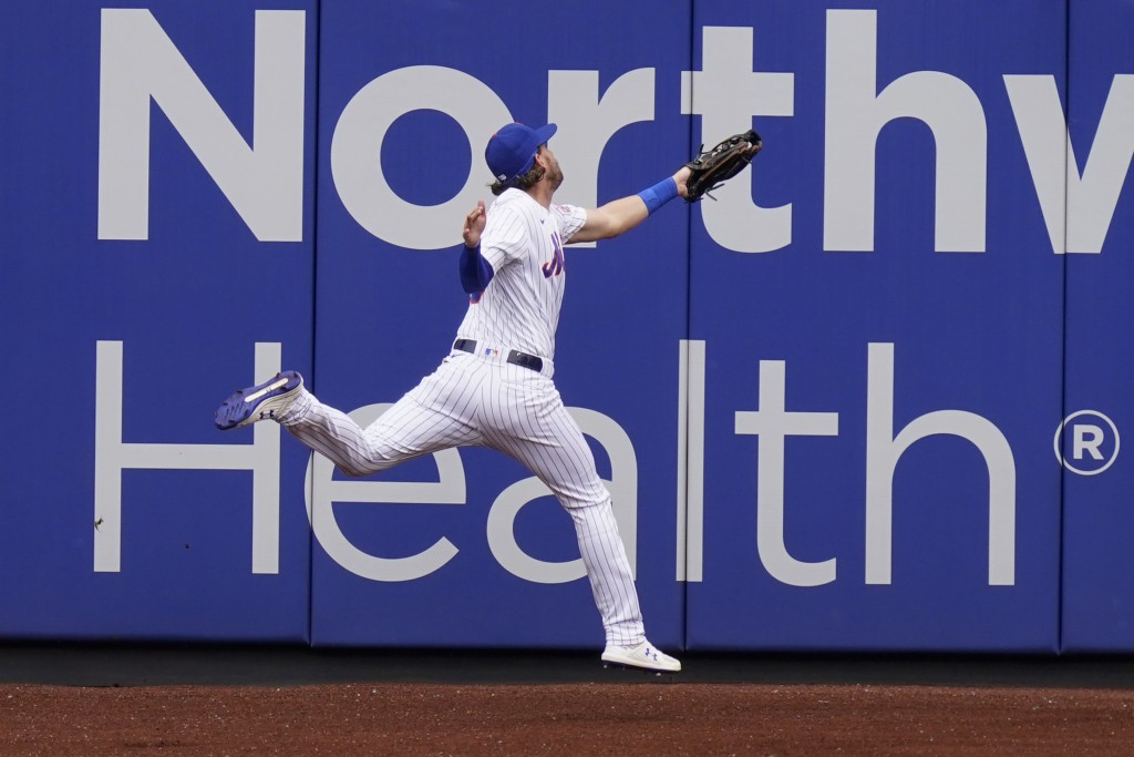 New York Mets left fielder Jeff McNeil injures himself while catching a fly ball during the first inning of a baseball game against the Washington Nat...