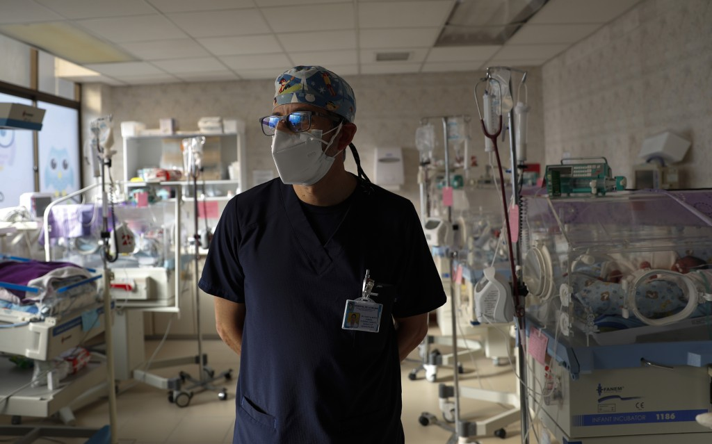 Pediatrician Dr. Hugo Tejerina stands in the intensive care unit of the Women's Hospital maternity ward in La Paz, Bolivia, Thursday, Aug. 13, 2020. T...