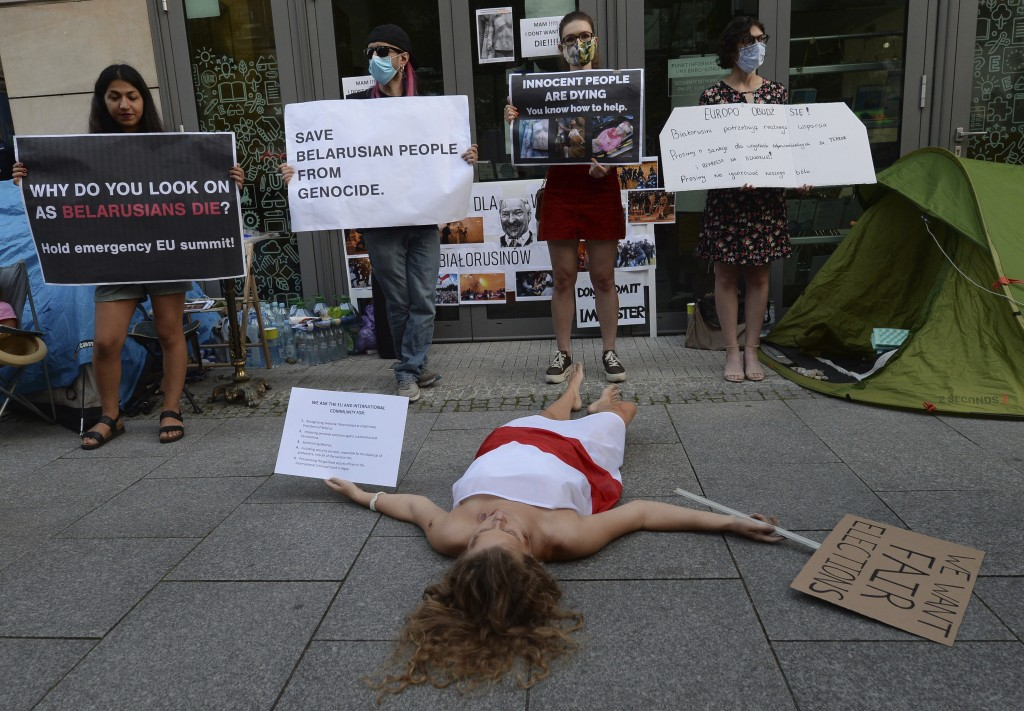 People demonstrate in support of Belarusians after a troubled weekend presidential vote, in Warsaw, Poland, Thursday, Aug. 13, 2020.   Supporters took...