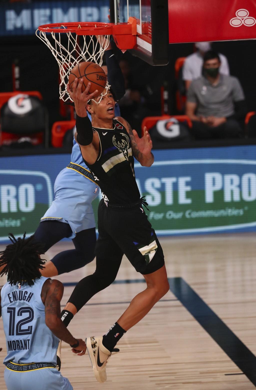 Milwaukee Bucks forward D.J. Wilson (5) shoots against the Memphis Grizzlies in the second half of an NBA basketball game Thursday, Aug. 13, 2020, in ...