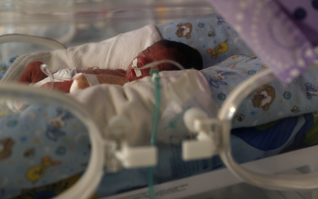 A newborn baby receives oxygen in an incubator in the intensive care unit of the Women's Hospital maternity ward in La Paz, Bolivia, Thursday, Aug. 13...