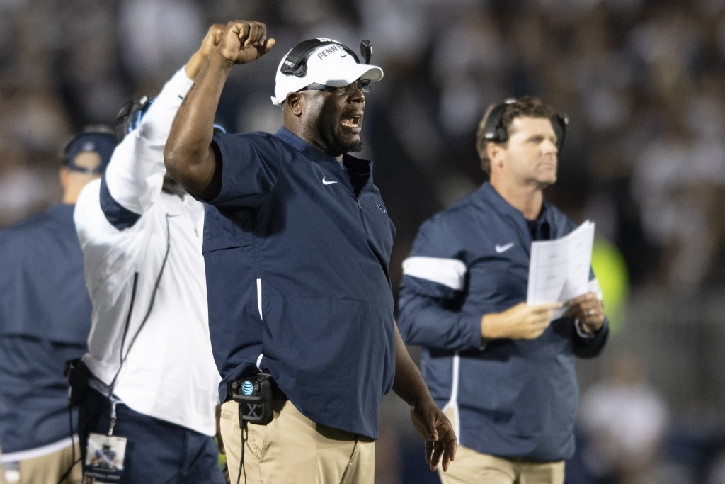 FILE - In this Sept. 7, 2019, file photo, then-Penn State defensive line coach Sean Spencer talks with his players in the second quarter of an NCAA co...