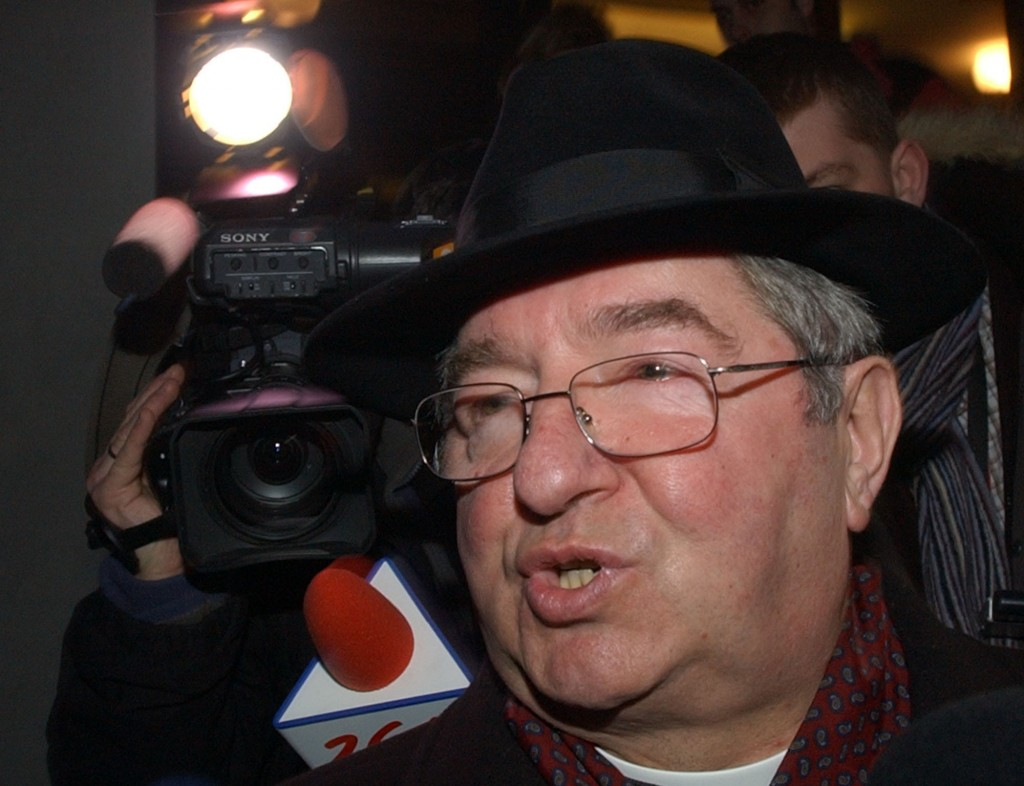 FILE -- In this Jan. 12, 2007 file photo archbishop Slawoj Leszek Glodz talks to reporters after an extraordinary meeting of Poland's Catholic Church,...