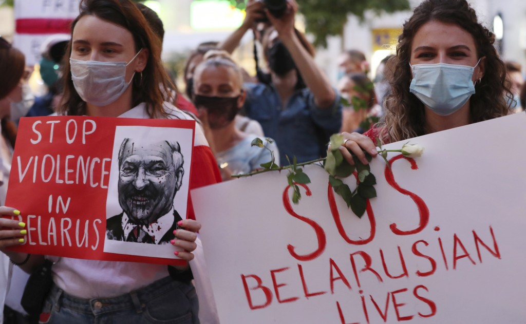 People demonstrate in support of Belarusians after a troubled weekend presidential vote, in Warsaw, Poland, Thursday, Aug. 13, 2020.  Supporters took ...