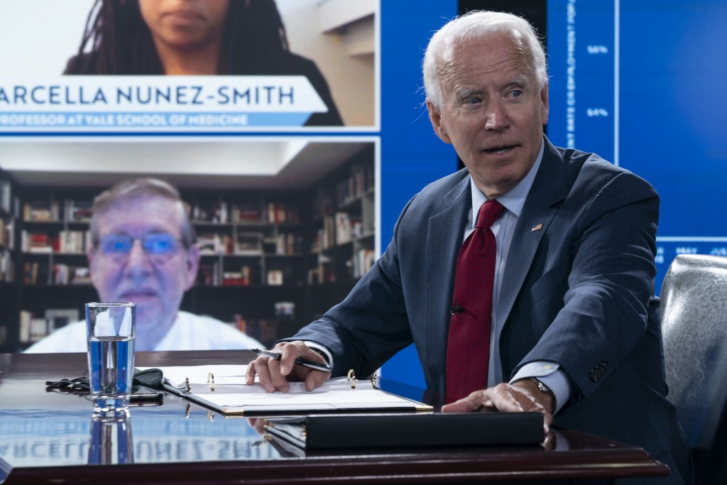 Democratic presidential candidate former Vice President Joe Biden speaks to media during a virtual a briefing on COVID-19 from public health experts i...