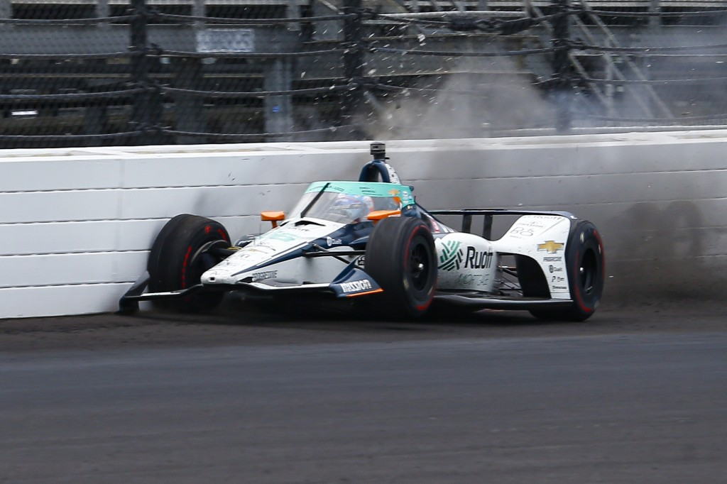 The car driven by Fernando Alonso, of Spain, hits the wall in the fourth turn during practice for the Indianapolis 500 auto race at Indianapolis Motor...