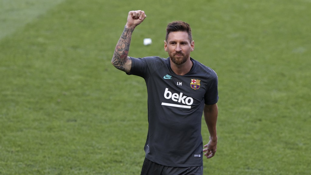 Barcelona's Lionel Messi gestures during a training session at the Luz stadium in Lisbon, Thursday Aug. 13, 2020. Barcelona will play Bayern Munich in...