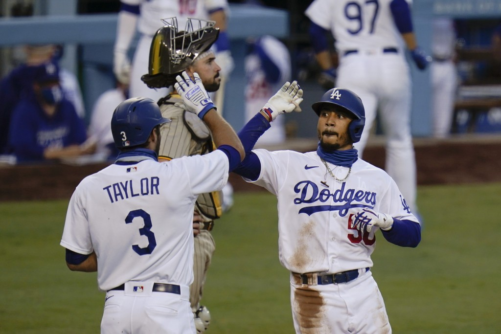 Los Angeles Dodgers' Mookie Betts, right, celebrates his two-run home run with Chris Taylor during the second inning of a baseball game against the Sa...