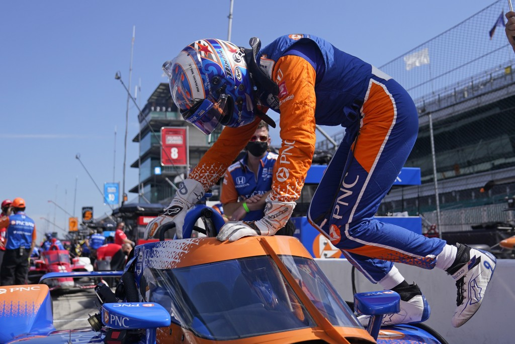 Scott Dixon, of New Zealand, climbs into his car during a practice session for the Indianapolis 500 auto race at Indianapolis Motor Speedway, Thursday...