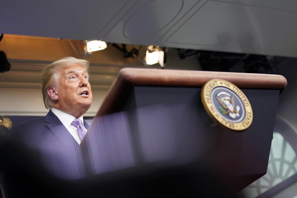 President Donald Trump speaks at a news conference in the James Brady Press Briefing Room at the White House, Thursday, Aug. 13, 2020, in Washington. ...