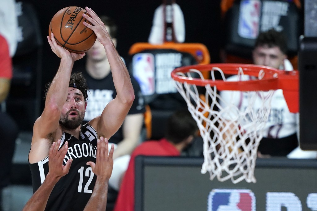 Brooklyn Nets' Joe Harris shoots against the Portland Trail Blazers during the second half of an NBA basketball game Thursday, Aug. 13, 2020, in Lake ...