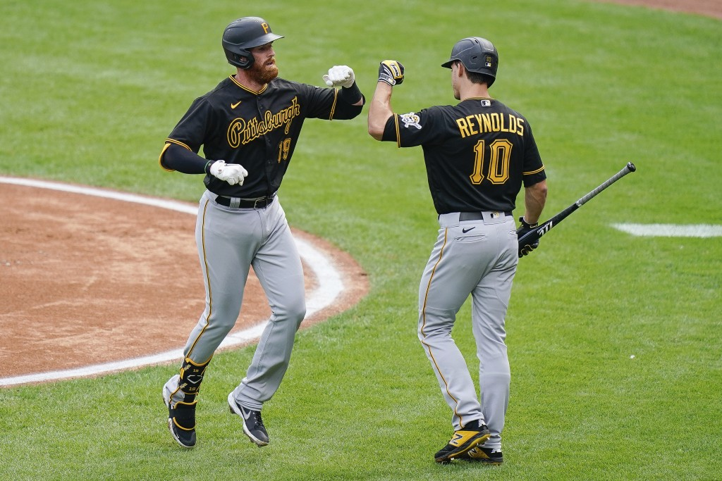 Pittsburgh Pirates' Colin Moran (19) celebrates with teammate Bryan Reynolds (10) after hitting a home run in the first inning of a baseball game agai...