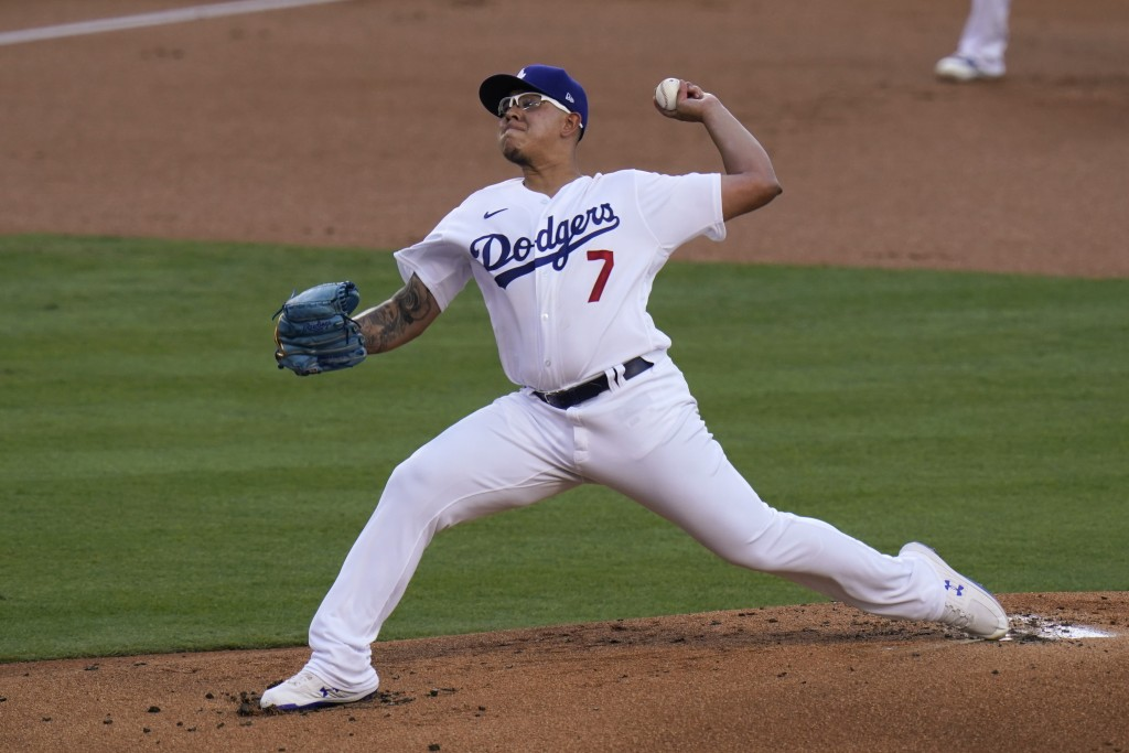 Los Angeles Dodgers starting pitcher Julio Urias throws against the San Diego Padres during the first inning of a baseball game Thursday, Aug. 13, 202...