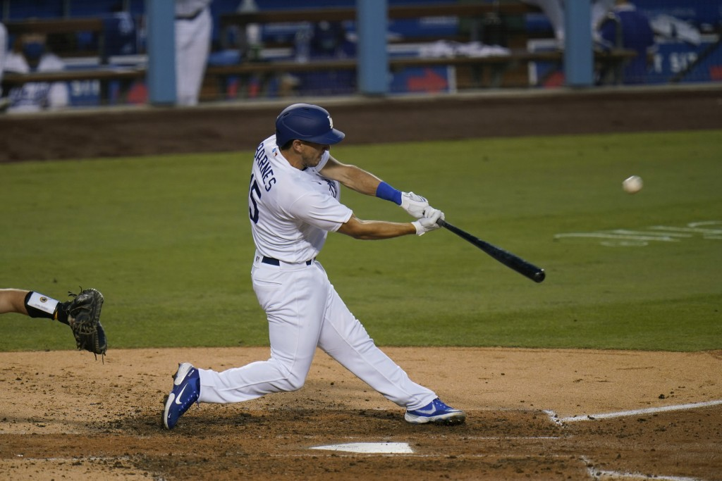 Los Angeles Dodgers' Austin Barnes hits a two-run home run during the fourth inning of a baseball game against the San Diego Padres, Thursday, Aug. 13...