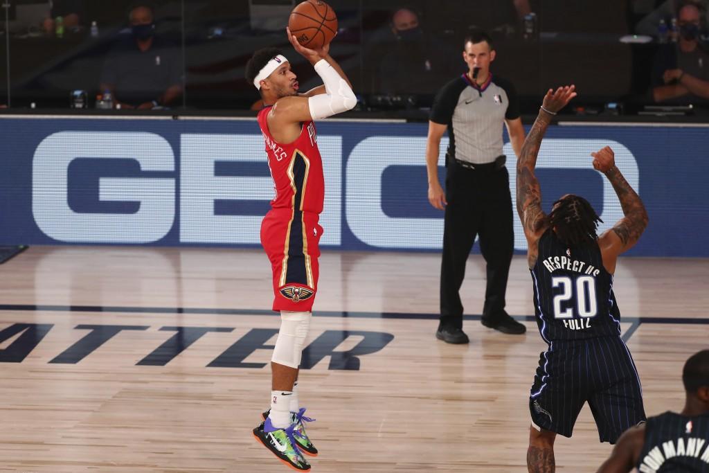 New Orleans Pelicans forward Josh Hart (3) shoots a three point basket over Orlando Magic guard Markelle Fultz (20) during the first half of an NBA ba...