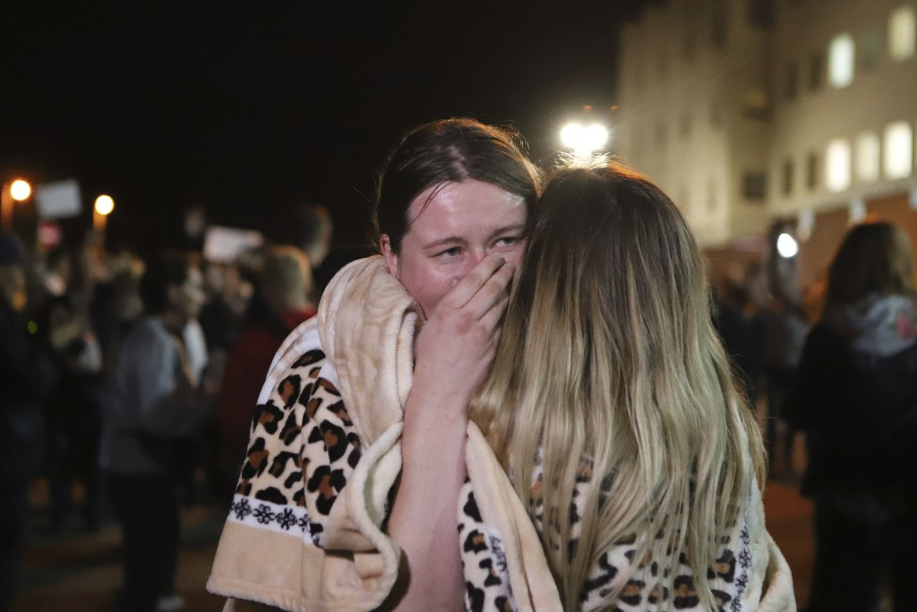 Relatives hug after being released from a detention center where protesters were detained during a mass rally following presidential election in Minsk...