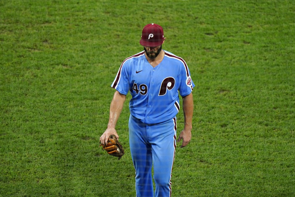 Philadelphia Phillies pitcher Jake Arrieta walks to the dugout after being pulled during the fifth inning of a baseball game against the Baltimore Ori...