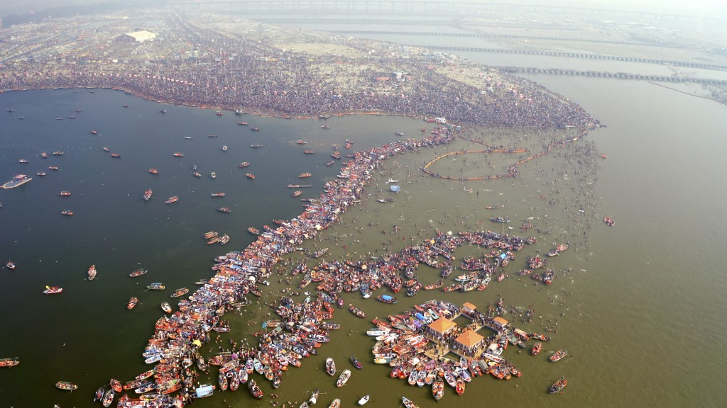"""This image released by National Geographic shows a large crowd swimming in the water during a Hindu festival in India, shown in the two-part special """"..."""