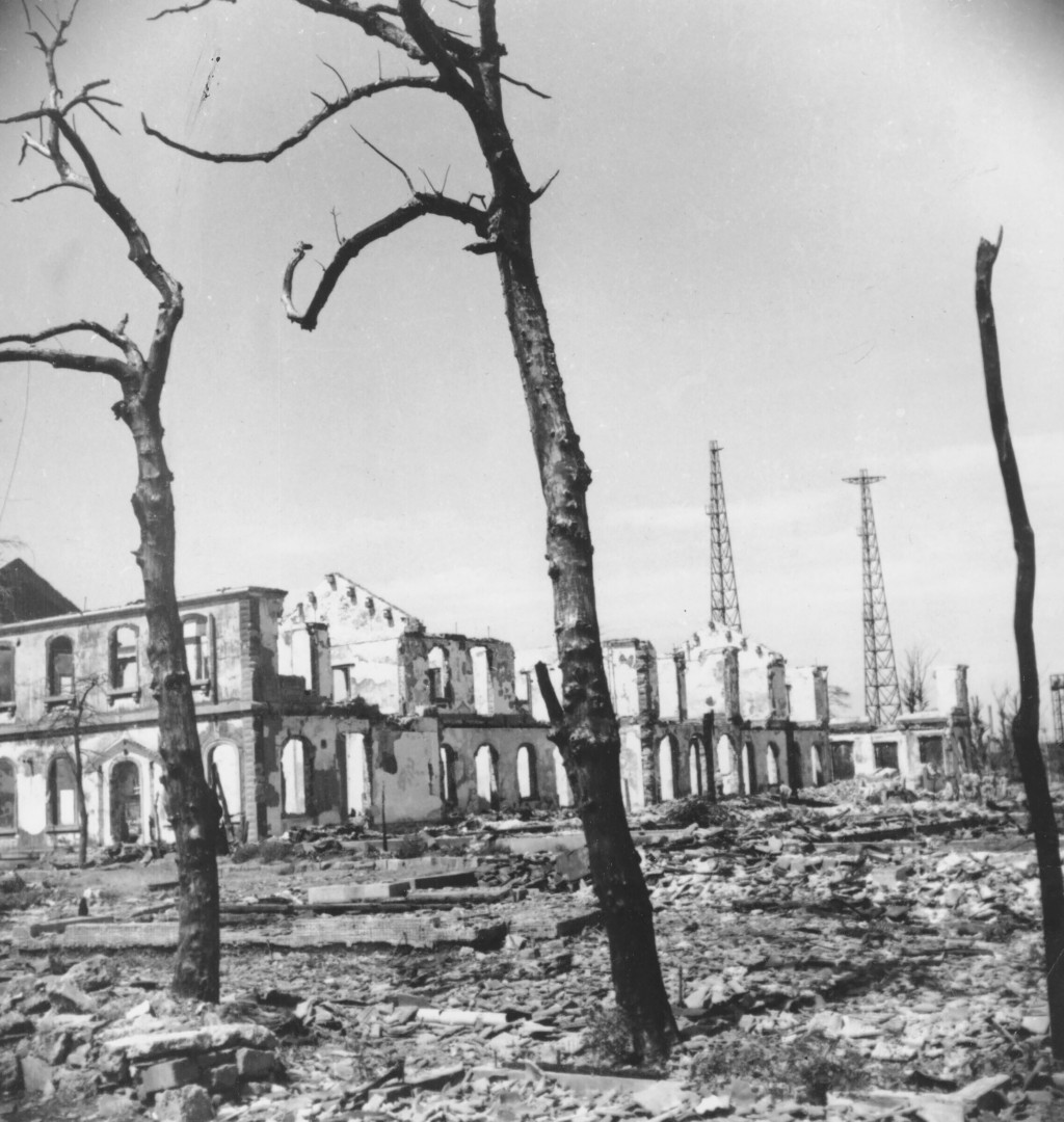 FILE - This Oct. 8, 1945, file photo shows gnarled tree branches and radio towers rearing up out of the rubble caused by bombs and fire in Tokyo durin...