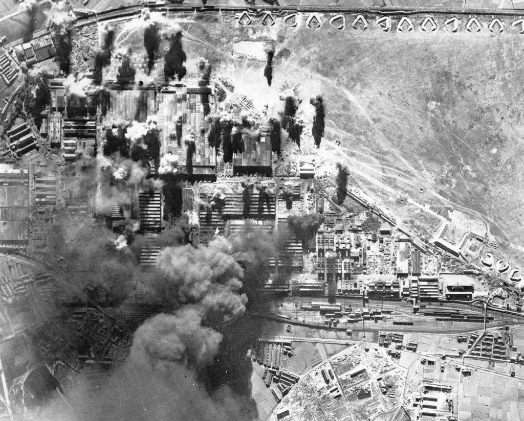FILE - In this Jan. 19, 1945, file photo, black smoke rises from burning targets at the Kawasaki aircraft plant in Kawasaki, near Tokyo, as U.S. plane...