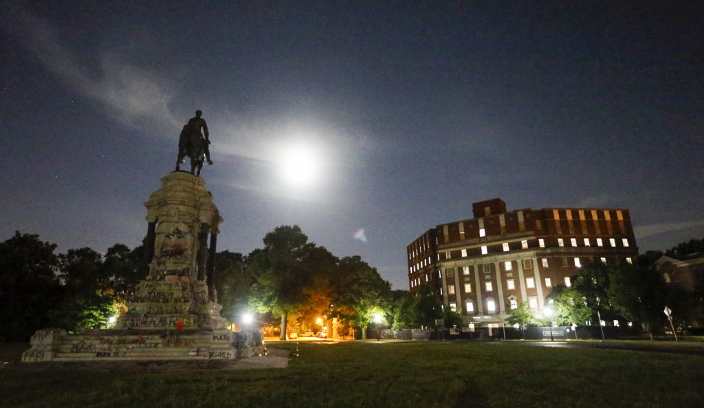 FILE - This Friday June 6, 2020 file photo shows the Moon as it illuminates the statue of Confederate General Robert E. Lee on Monument Avenue in Rich...