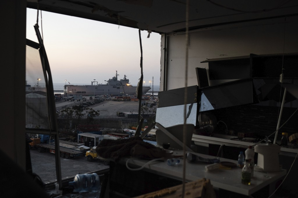 French helicopter carrier Tonnerre, top left, is docked near the site of the Aug. 4 explosion, in Beirut, Lebanon, Friday, Aug. 14, 2020. (AP Photo/Fe...