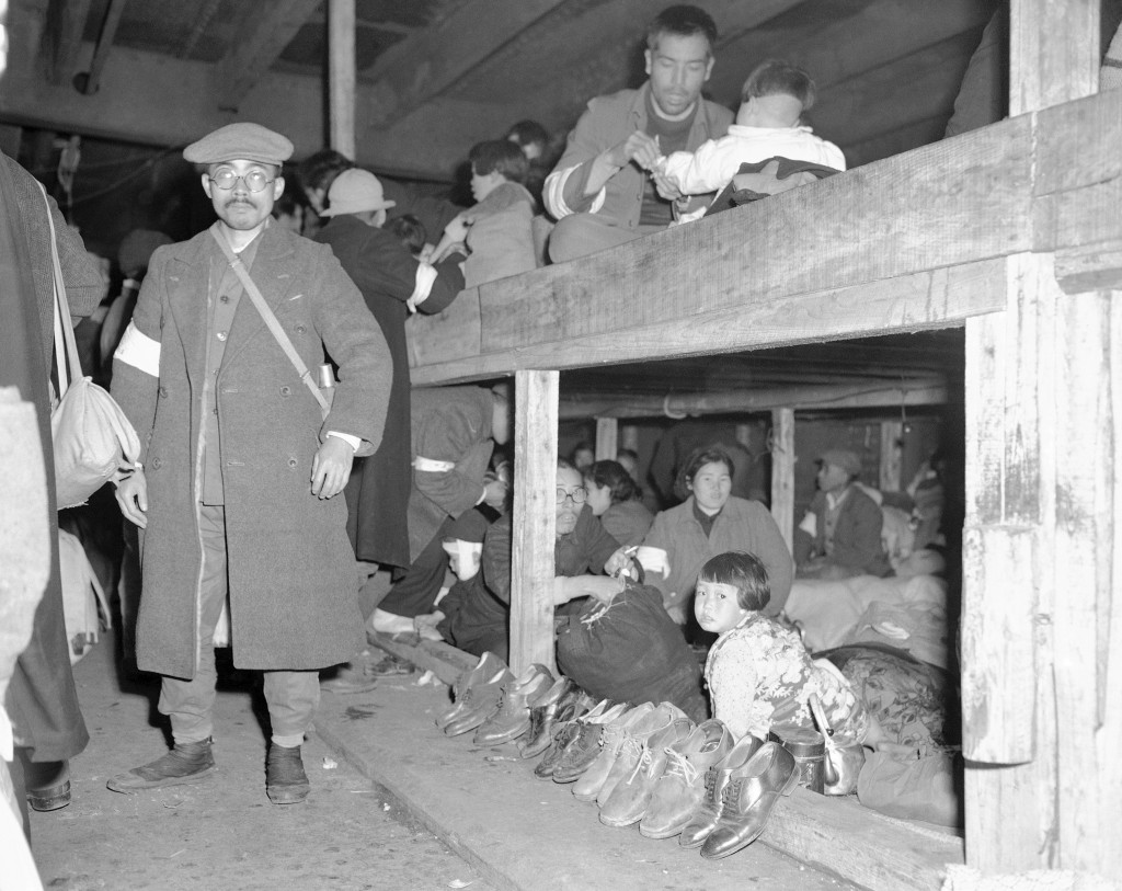 FILE - In this Dec. 16, 1945, file photo, Japanese repatriates, who had led a life of comparative ease in China during World War II, find themselves a...
