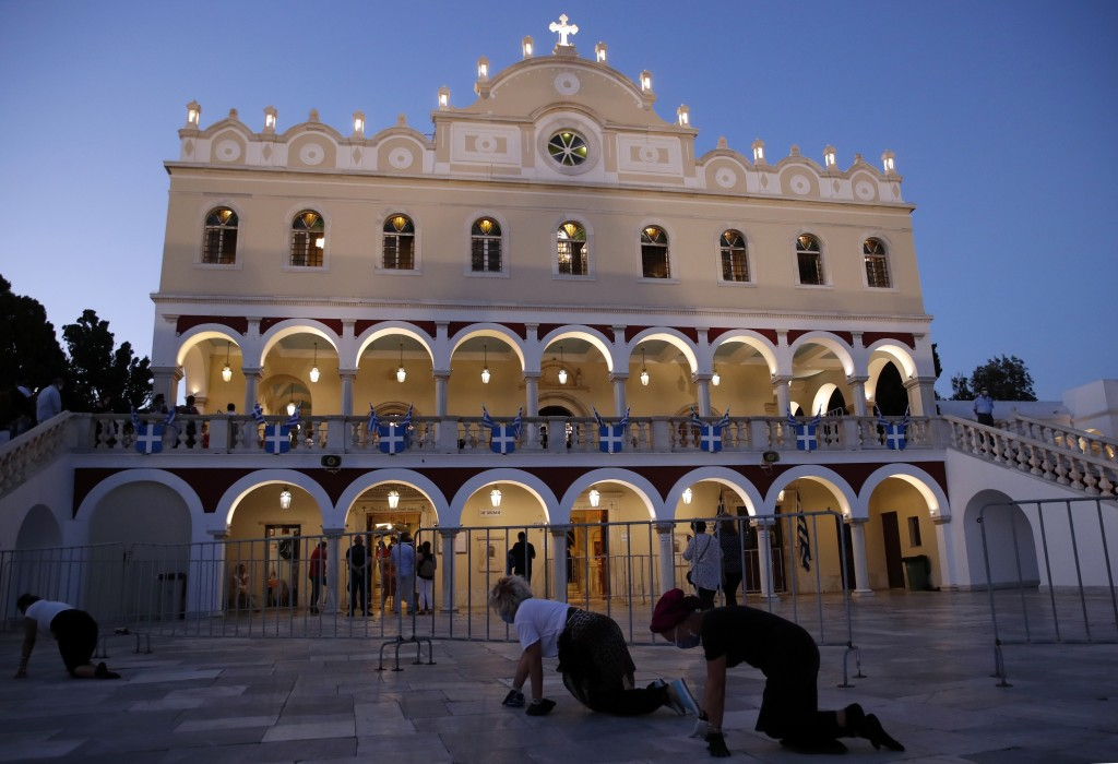 Pilgrims crawl in front of the Holy Church of Panagia of Tinos, on the Aegean island of Tinos, Greece, on Friday, Aug. 14, 2020. For nearly 200 years,...