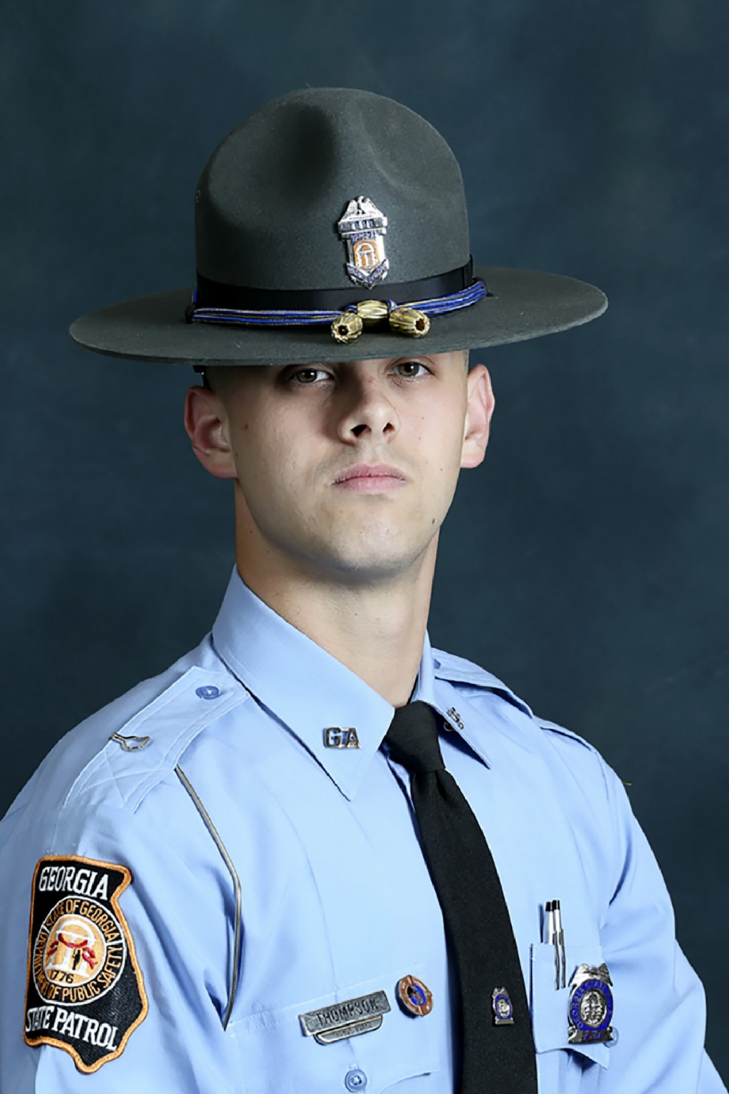 In this undated photo released by the Georgia Department of Public Safety, State trooper Jacob Gordon Thompson is seen in an official portrait. The Ge...
