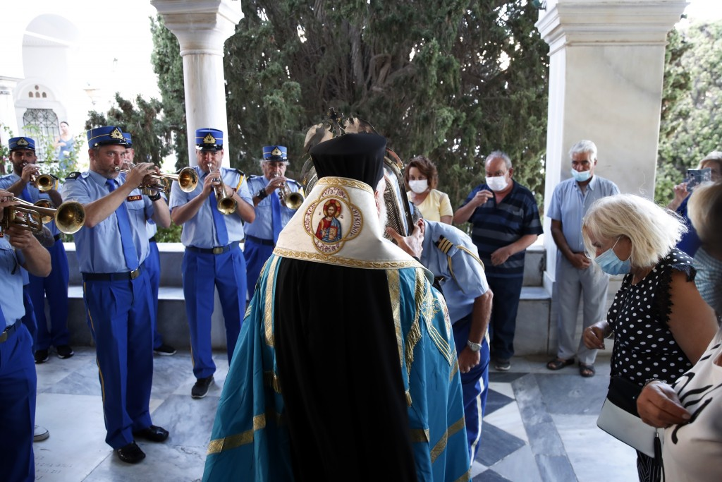 Metropolitan Dorotheos of Syros and Tinos holds an icon believed to perform miracles during a service in the Holy Church of Panagia, on the Aegean isl...