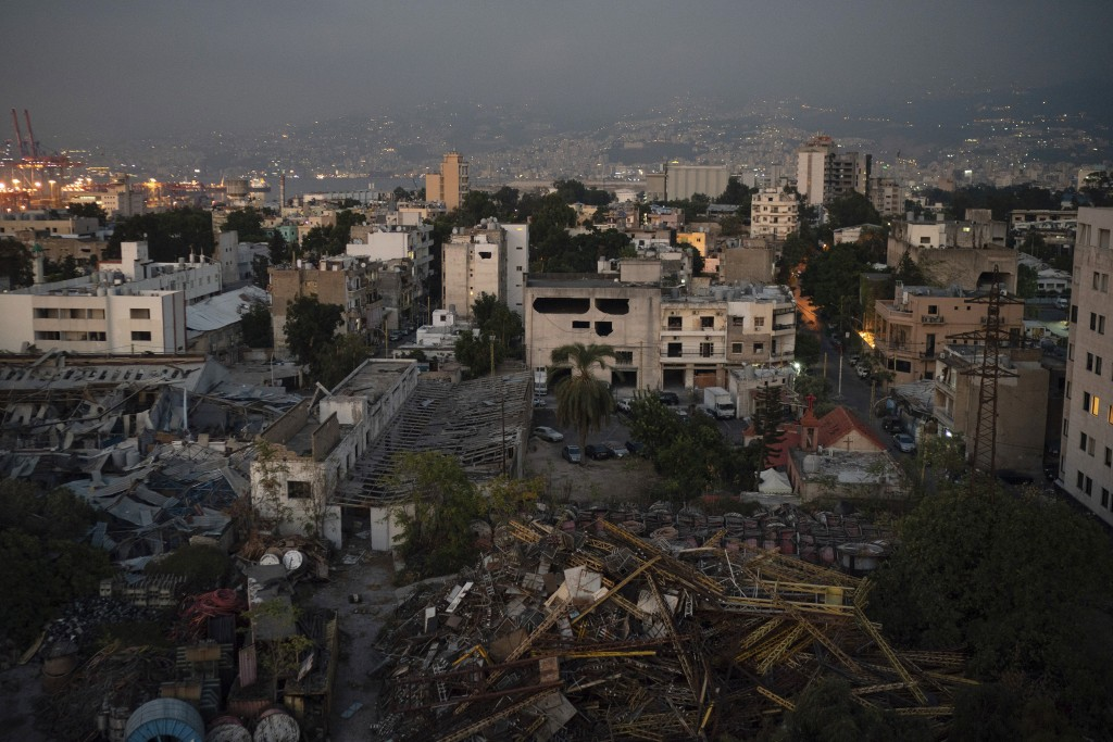 Damaged buildings are seen near the site of last week's massive explosion in the port of Beirut, Lebanon, Friday, Aug. 14, 2020. (AP Photo/Felipe Dana...