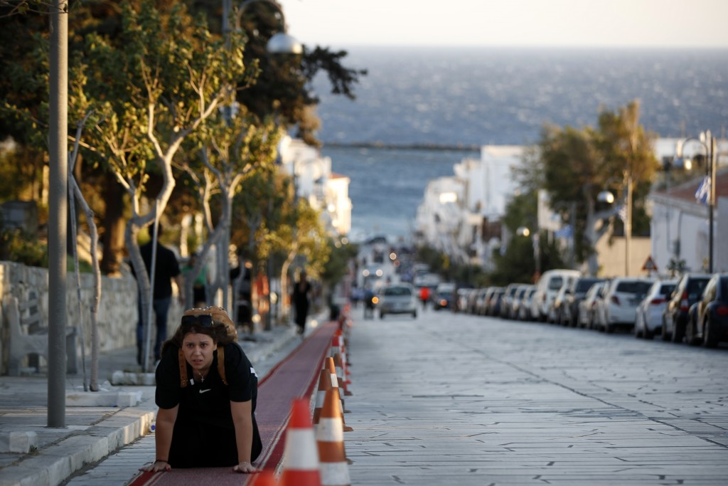A pilgrim crawls from the port to the Holy Church of Panagia of Tinos, on the Aegean island of Tinos, Greece, on Thursday, Aug. 13, 2020. For nearly 2...