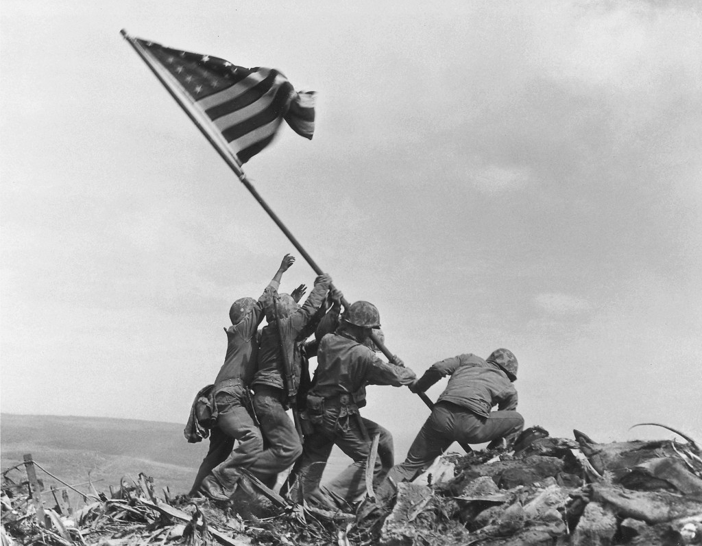FILE - In this Feb. 23, 1945, file photo, U.S. Marines of the 28th Regiment, 5th Division, raise an American flag atop Mt. Suribachi, Iwo Jima, Japan....