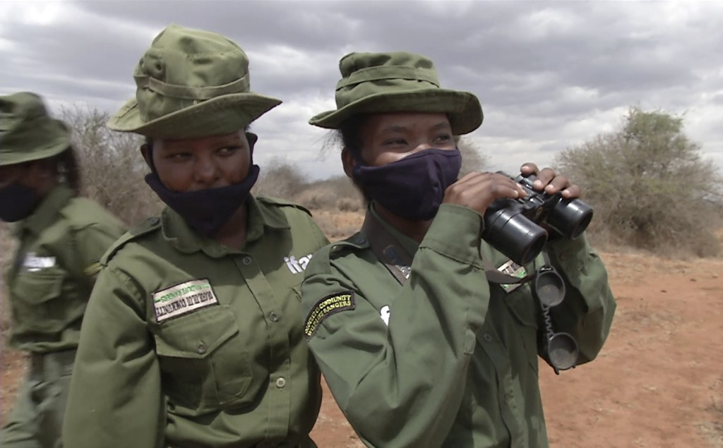 "In this image made from video, Purity Amleset, 24, right, and other female wildlife rangers from ""Team Lioness"" patrol in Amboseli national park, Keny..."