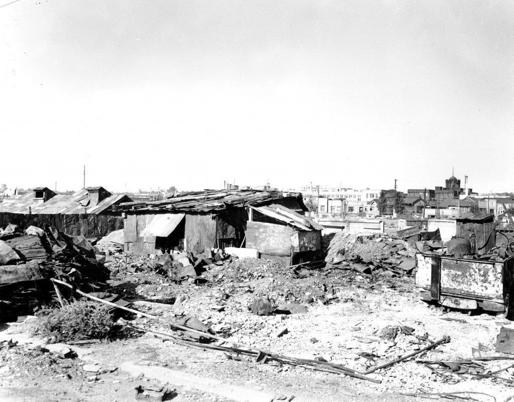 FILE - This Sept. 7, 1945, file photo shows temporary housing built from galvanized iron roofing of burned buildings in Tokyo. With the exception of t...