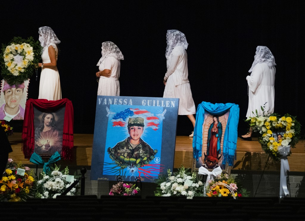 Ladies from the Queen of Peace Church walk to the stage to pray the rosary during the memorial service of U.S. Army Specialist Vanessa Guillen at the ...