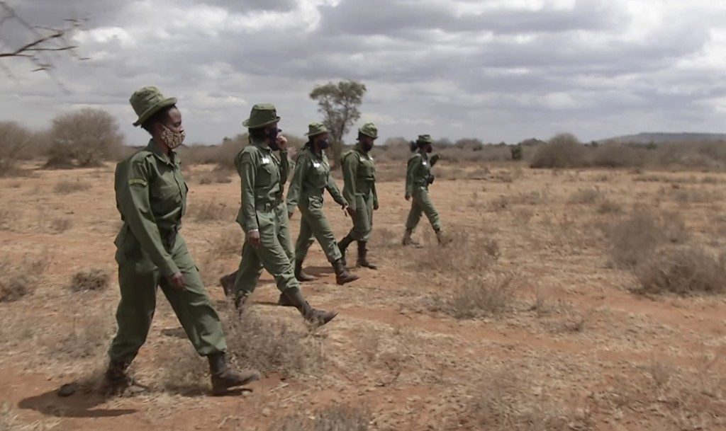 "In this image made from video, female wildlife rangers from ""Team Lioness"" patrol in Amboseli national park, Kenya Friday, Jul. 31, 2020. On the sweep..."