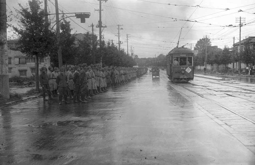 FILE - In this Aug. 31, 1945, file photo, a battalion of Japanese soldiers lines on a Tokyo street several days before American military forces offici...