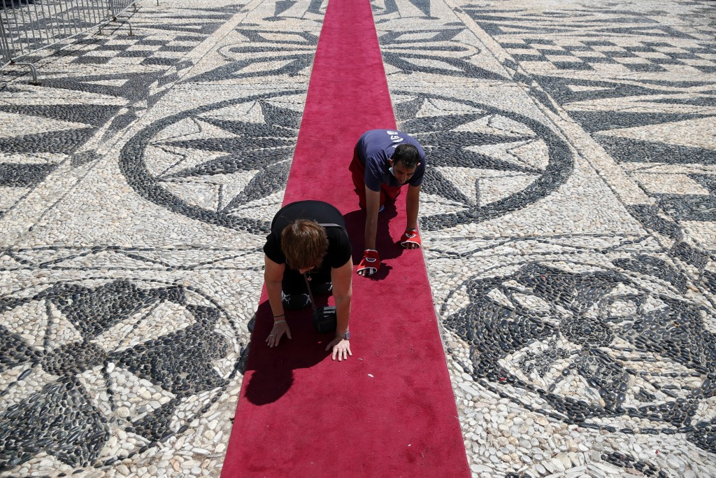 Pilgrims crawl outside the Holy Church of Panagia of Tinos, on the Aegean island of Tinos, Greece, on Thursday, Aug. 13, 2020. For nearly 200 years, G...
