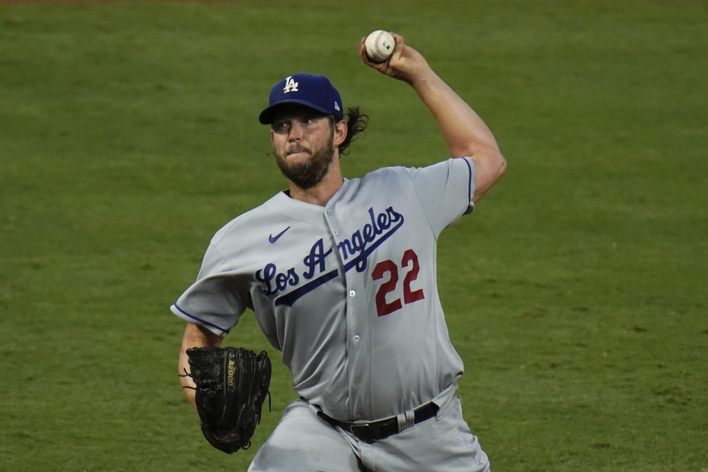 Los Angeles Dodgers starting pitcher Clayton Kershaw throws against the Los Angeles Angels during the fourth inning of a baseball game, Friday, Aug. 1...