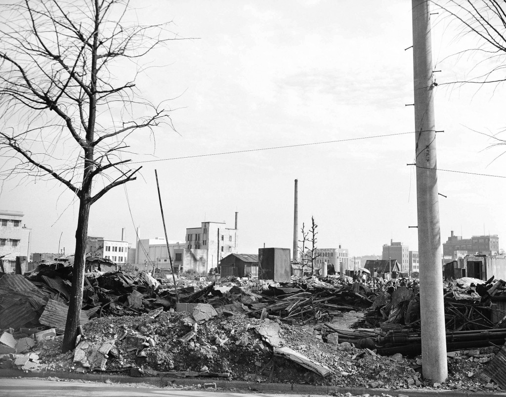 FILE - This Sept. 1, 1945, file photo shows destroyed business buildings in the city of Yokohama, near Tokyo. U.S. B-29's bombing raids left ruins deb...