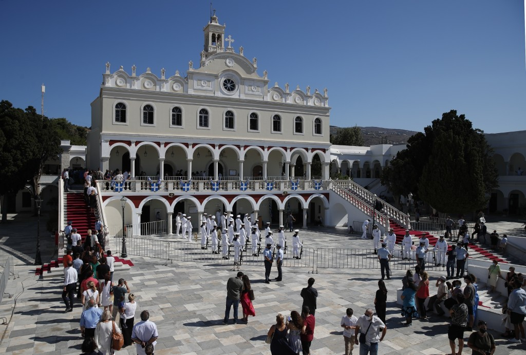 Pilgrims stand in a queue as they wait to enter the Holy Church of Panagia of Tinos, on the Aegean island of Tinos, Greece, on Saturday, Aug. 15, 2020...