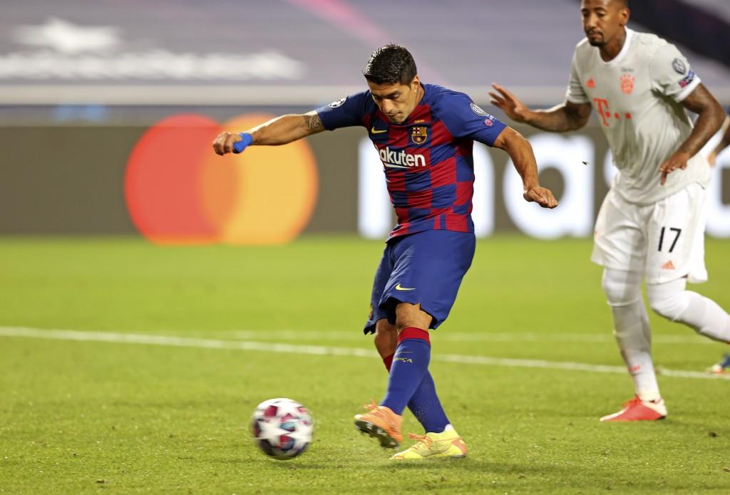 Barcelona's Luis Suarez, left, scores a goal during the Champions League quarterfinal soccer match between Barcelona and Bayern Munich in Lisbon, Port...