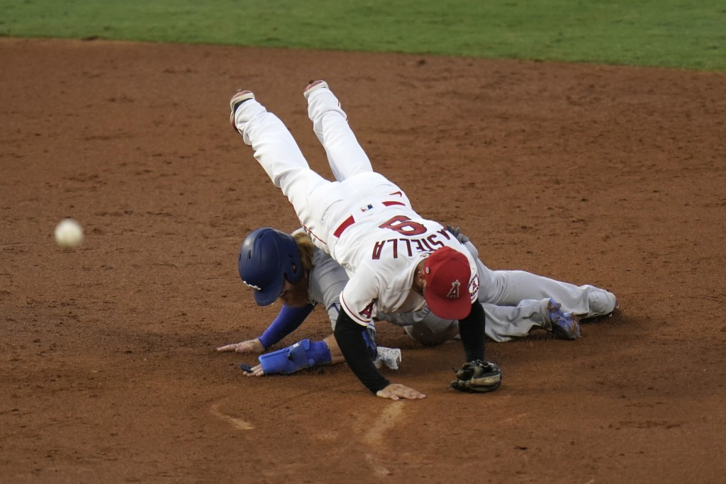 Los Angeles Angels' Tommy La Stella, top, tumbles over Los Angeles Dodgers' Justin Turner after forcing him out during the third inning of a baseball ...