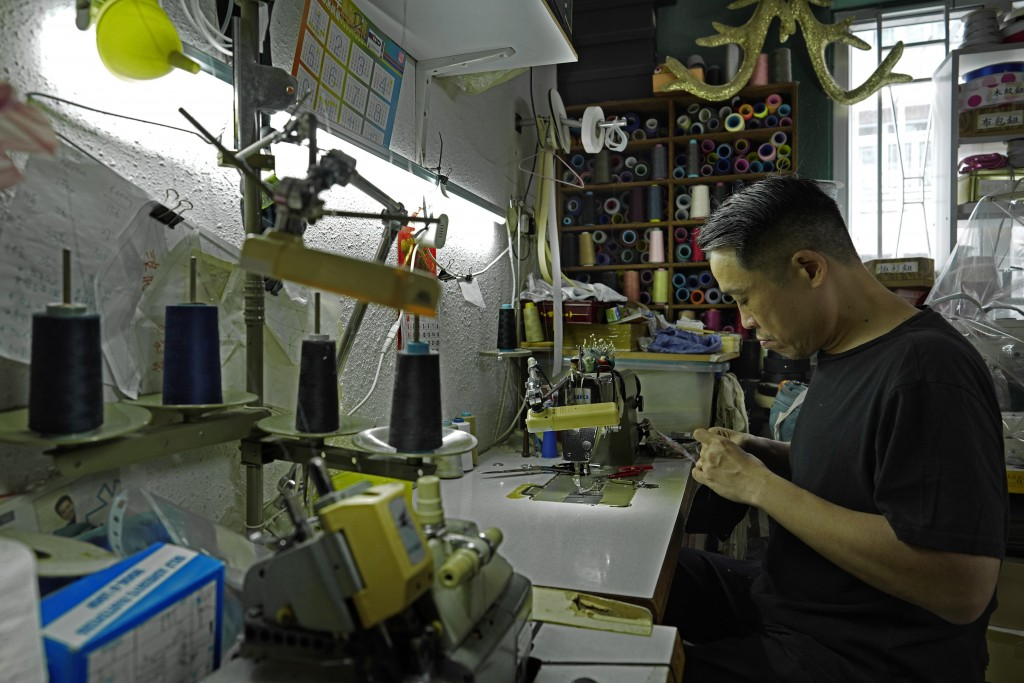 Edmond Kok, a Hong Kong theater costume designer and actor, is making a face mask at his studio in Hong Kong Thursday, Aug. 6, 2020. With little theat...