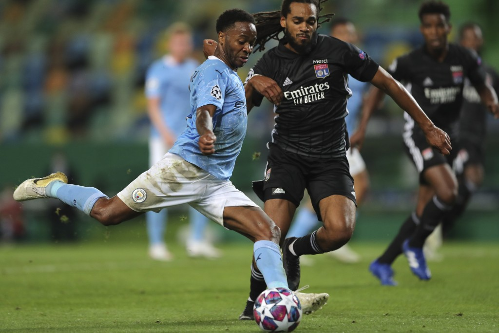 Manchester City's Raheem Sterling gets in a shot during the Champions League quarterfinal soccer match between Lyon and Manchester City at the Jose Al...