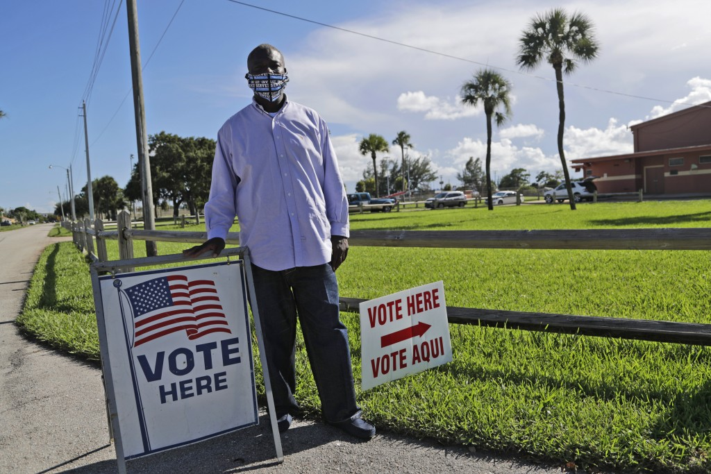 William Freeman, 51, poses for a photograph outside of his polling station, Monday, Aug. 10, 2020, in Riviera Beach, Fla. Freeman recently registered ...