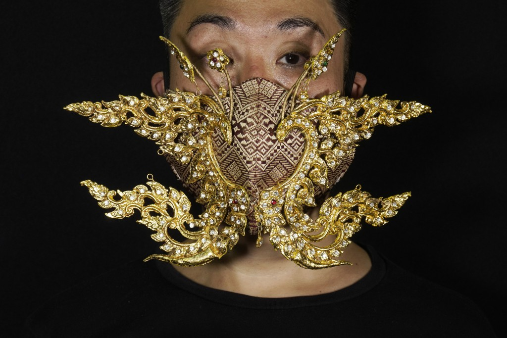 Edmond Kok, a Hong Kong theater costume designer and actor, wearing a face mask inspired by the decoration of Thai temple to Kok's facein Hong Kong T...